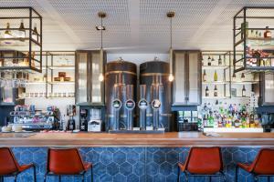 El salón o zona de bar de Ibis Styles A Coruna