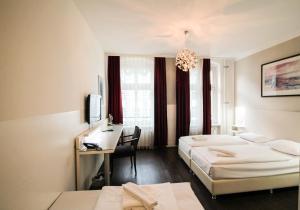 Ein Bett oder Betten in einem Zimmer der Unterkunft Hotel Prens Berlin