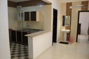 A cozinha ou cozinha compacta de Mozn Abha Furnished Units