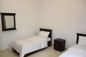 Cama ou camas em um quarto em Mozn Abha Furnished Units