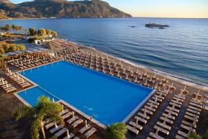 A view of the pool at Alimounda Mare Hotel or nearby