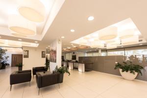The lobby or reception area at Alimounda Mare Hotel