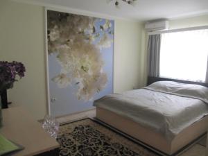Кровать или кровати в номере Гостиница Георгиевская