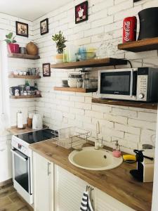 Kuchyň nebo kuchyňský kout v ubytování Vista Suites 1-2