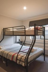 A bunk bed or bunk beds in a room at Montebello