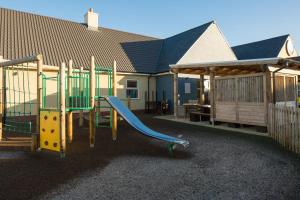 Children's play area at The Raven's Cliff Lodge by Marston's Inns