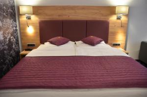 Кровать или кровати в номере Hotel Touric