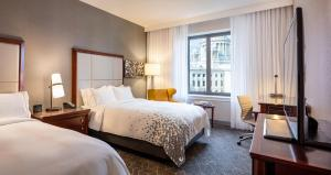 A bed or beds in a room at Renaissance Providence Downtown Hotel