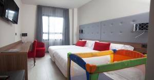 Cama o camas de una habitación en Hotel K10
