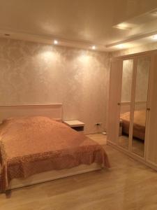 Кровать или кровати в номере Апартаменты на Новороссийской