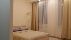 Кровать или кровати в номере Квартира с видом на Москву-реку на 23 этаже