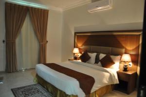 Cama ou camas em um quarto em SHALLY RESIDENCE 2