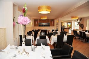 Ein Restaurant oder anderes Speiselokal in der Unterkunft Hotelanlage Starick