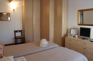 A bed or beds in a room at B. & B. NABUCCO