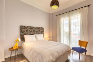 A bed or beds in a room at Endemic - Concept Apartment