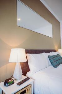 Кровать или кровати в номере Artesian Spa Motel