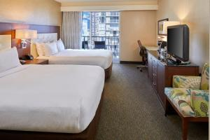 A television and/or entertainment center at DoubleTree by Hilton Alana - Waikiki Beach