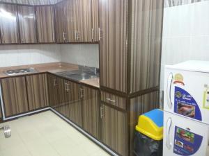 A cozinha ou cozinha compacta de زهرة المنار 1 للوحدات السكنية