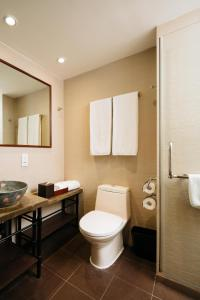 A bathroom at Butterfly on Wellington Boutique Hotel Central