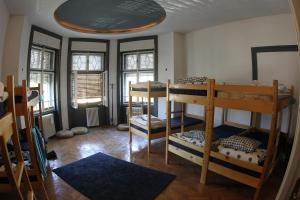 A bunk bed or bunk beds in a room at Hostel Costel Timisoara