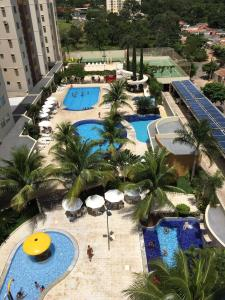 A view of the pool at Flat Prive das Thermas II - R3 Caldas or nearby