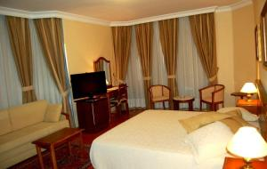 A bed or beds in a room at Hotel Jardim