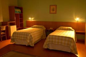 A bed or beds in a room at Pampa Hotel