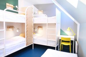 A bunk bed or bunk beds in a room at NETIZEN Saint Petersburg Centre