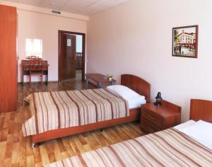 Кровать или кровати в номере Бон Отель