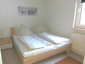 Ein Bett oder Betten in einem Zimmer der Unterkunft Ferienwohnung Hochsauerland