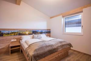 A bed or beds in a room at Residenz Gamper