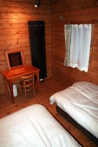 A bed or beds in a room at Log Cottage Epoch