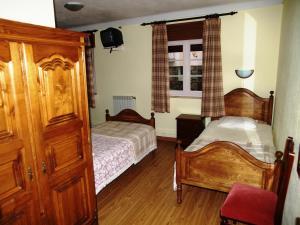 Uma cama ou camas num quarto em Estrela