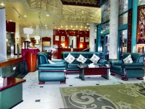 The lobby or reception area at Grand Mayfair Hotel