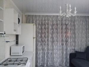 """Ванная комната в """"Апартаменты на Проспекте Ленинского Комсомола 63"""""""