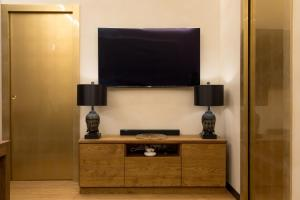 A television and/or entertainment centre at Civico Cinque Home Luxury Apartment