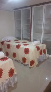 A bed or beds in a room at Hostel Quintonido