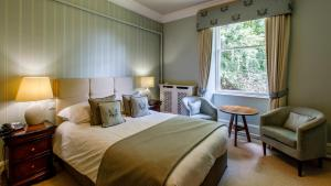 A bed or beds in a room at Tor-Na-Coille Hotel