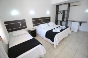 A bed or beds in a room at Pousada Remanso