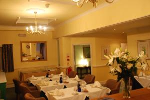 A restaurant or other place to eat at Beech House Hotel