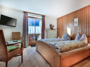 Ein Bett oder Betten in einem Zimmer der Unterkunft Haus Lindenbichl