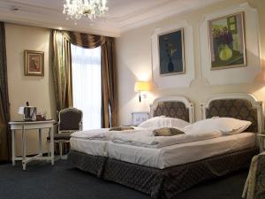 Postel nebo postele na pokoji v ubytování Esplanade Spa and Golf Resort