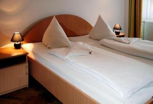 Ein Bett oder Betten in einem Zimmer der Unterkunft Suite Hotel 200m zum Prater
