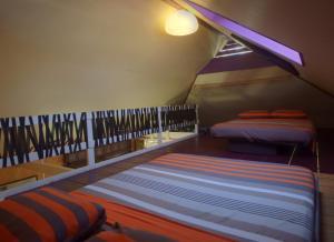 Cama ou camas em um quarto em JUSTMOOREA Location Haapiti