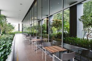 Ein Restaurant oder anderes Speiselokal in der Unterkunft Hotel Traveltine