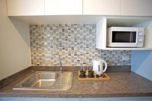 A kitchen or kitchenette at Cinnamon Residence