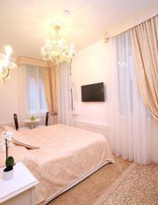 Кровать или кровати в номере Antico Mercato