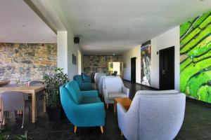 Uma área de estar em Agua Hotels Mondim de Basto