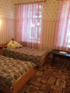 Кровать или кровати в номере Гостиница Ризоположенская