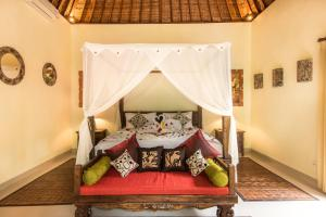 A bed or beds in a room at Bunut Garden Luxury Private Villa
